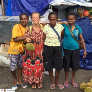 Tina from Fit Shortie posing for a picture with native people in West-Papua. They were selling durian fruits.