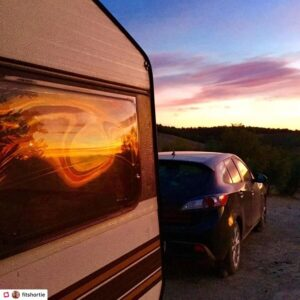 Sun rays reflecting on our caravan window at sunset in Granada Spain